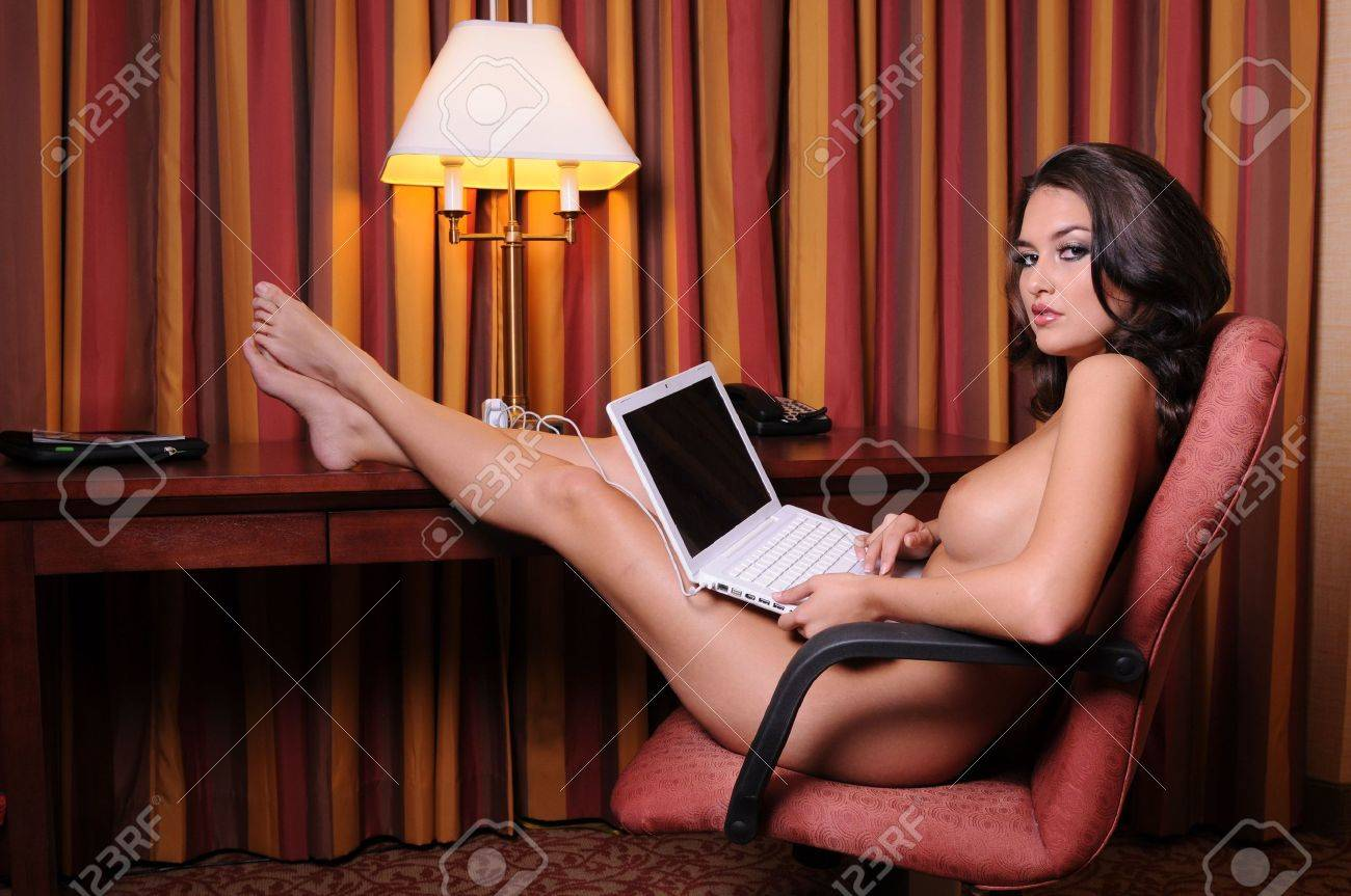 Beautiful nude brunette working on her laptop Stock Photo - 5558207