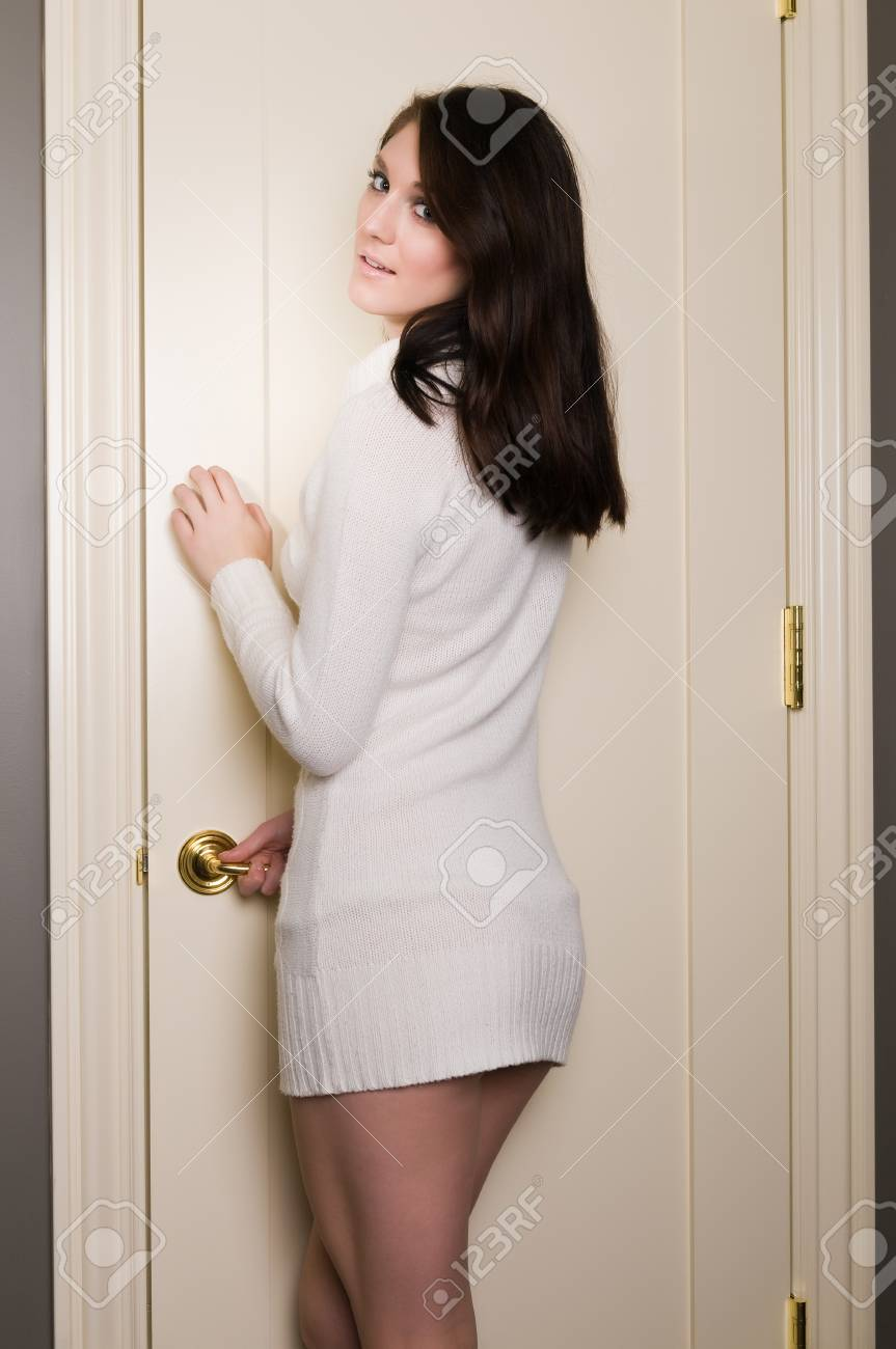 Pretty young brunette in a white knit sweater Stock Photo - 8437272