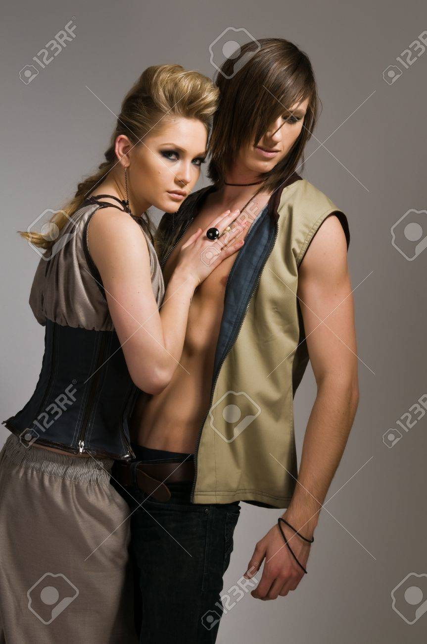 Beautiful tall couple in stylish vests and pants Stock Photo - 9064328