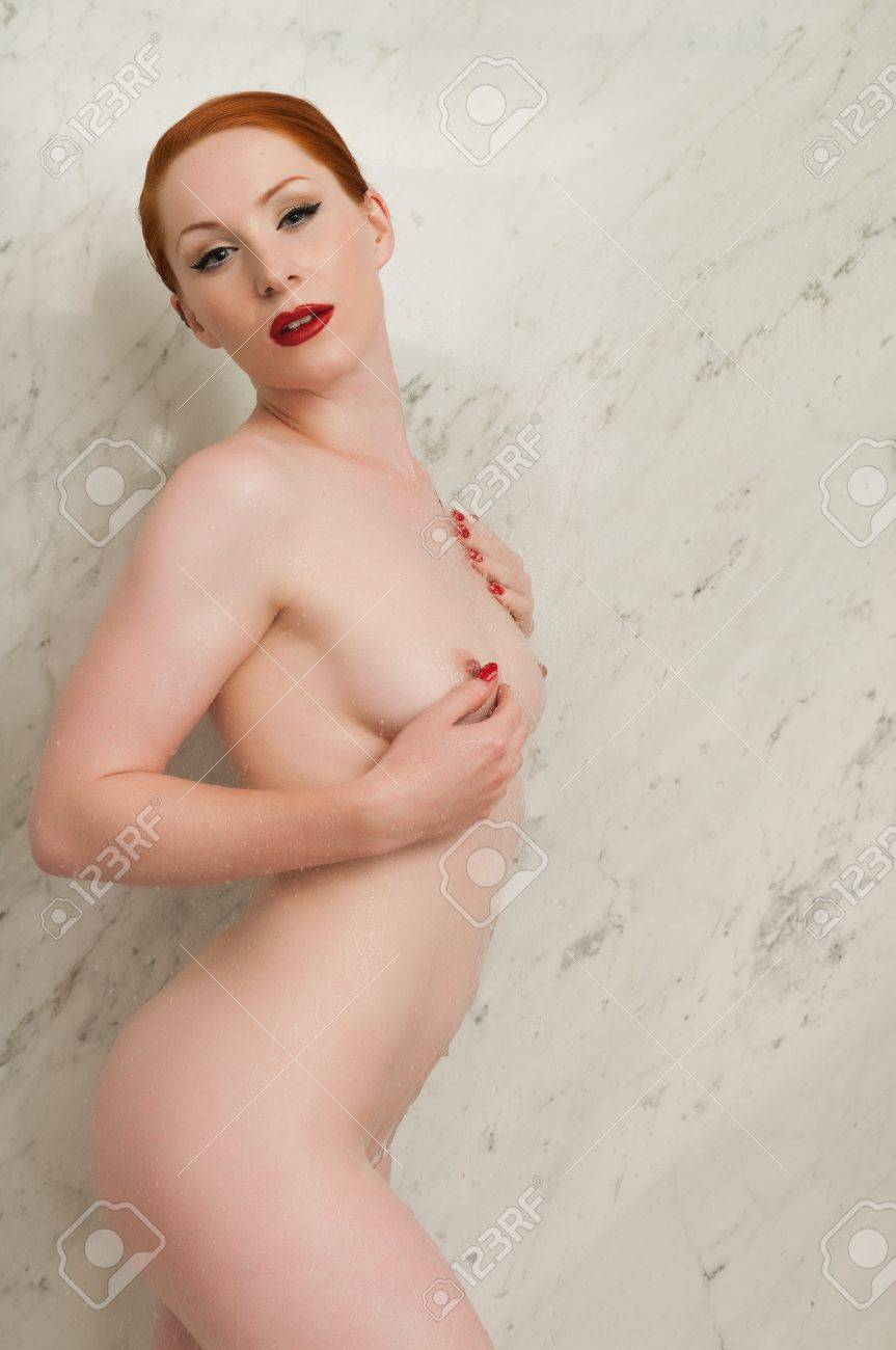 Lovely pale redhead in the shower Stock Photo - 9878370