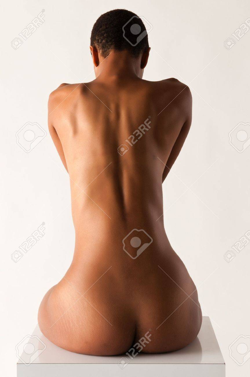 Slender young black woman posing nude on white Stock Photo - 10001926