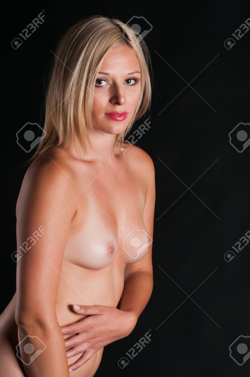 Beautiful tall blonde standing nude in shadow Stock Photo - 10084812