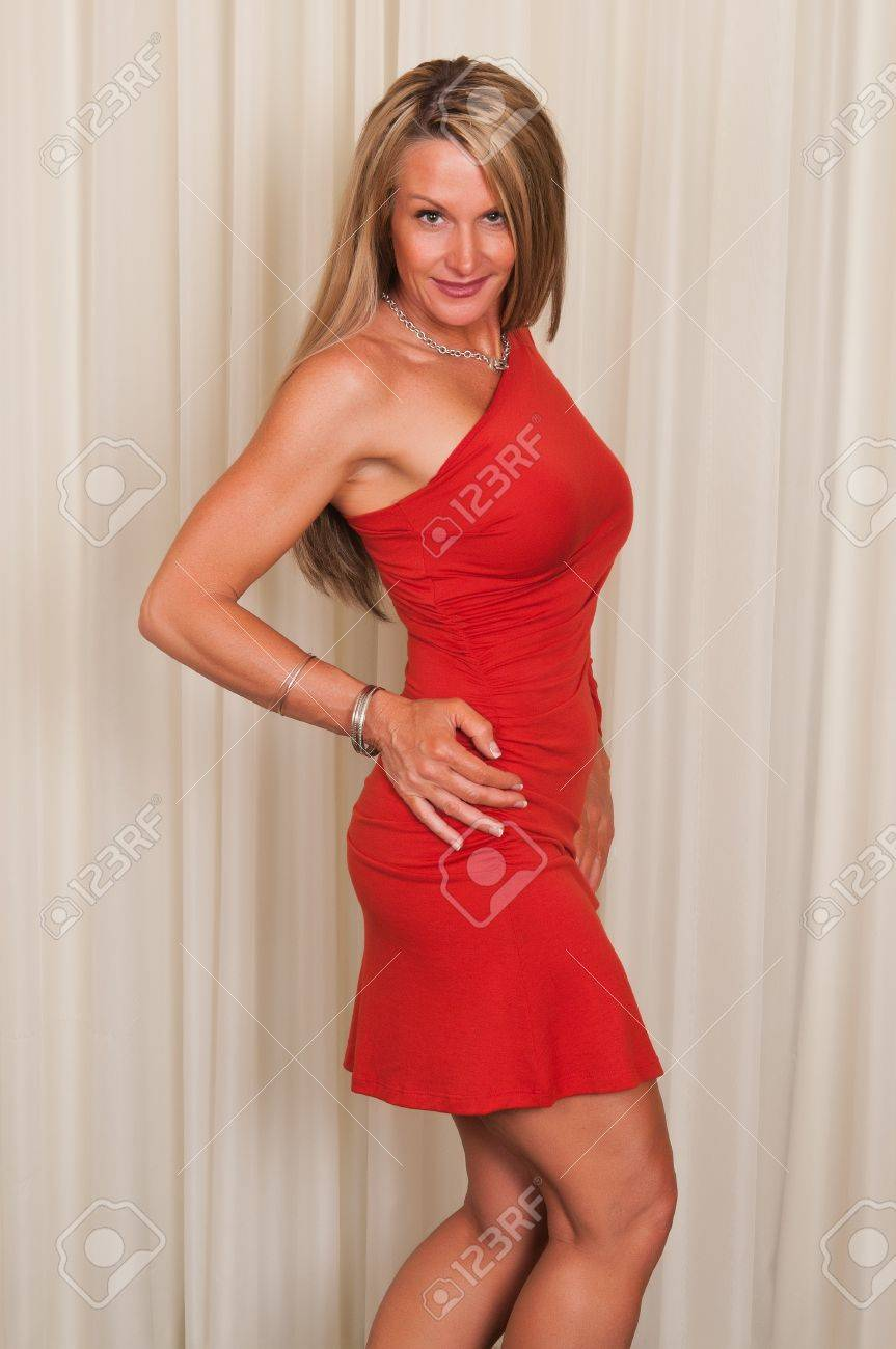 Beautiful mature blonde in a red dress Stock Photo - 10388024