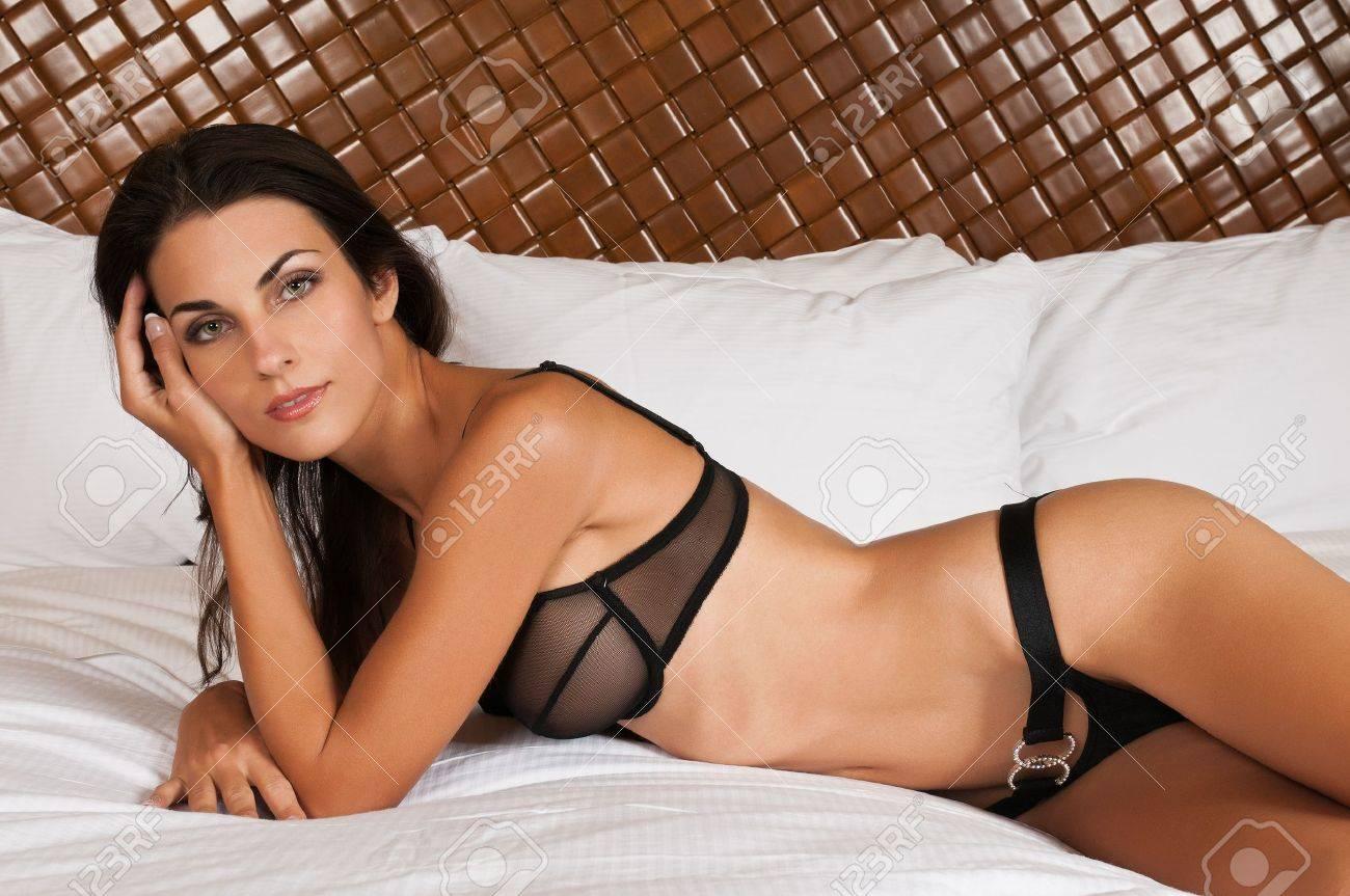 Beautiful slender brunette in sheer black lingerie Stock Photo - 11322013