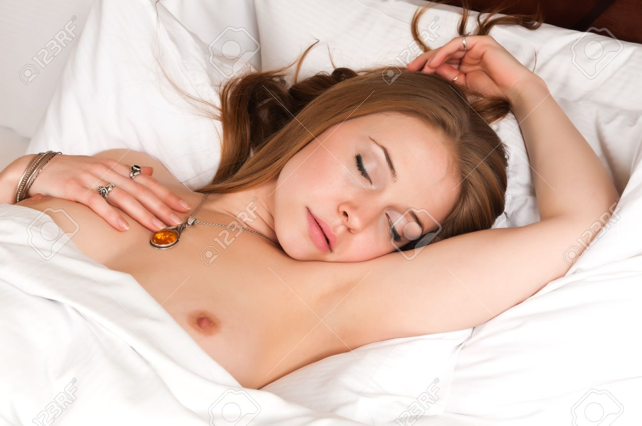 Pretty young brunette nude in bed Stock Photo - 11736953