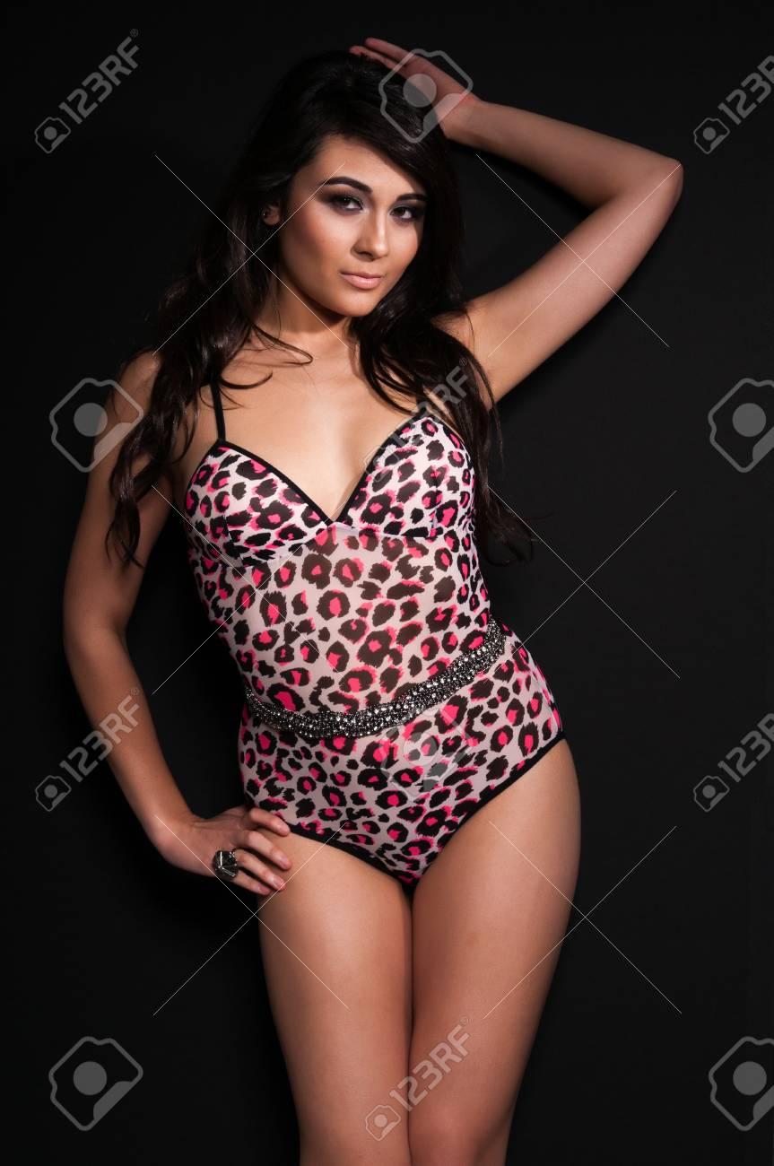 197b3fd8c380 Pretty young multiracial woman in an animal print leotard Stock Photo -  11736978
