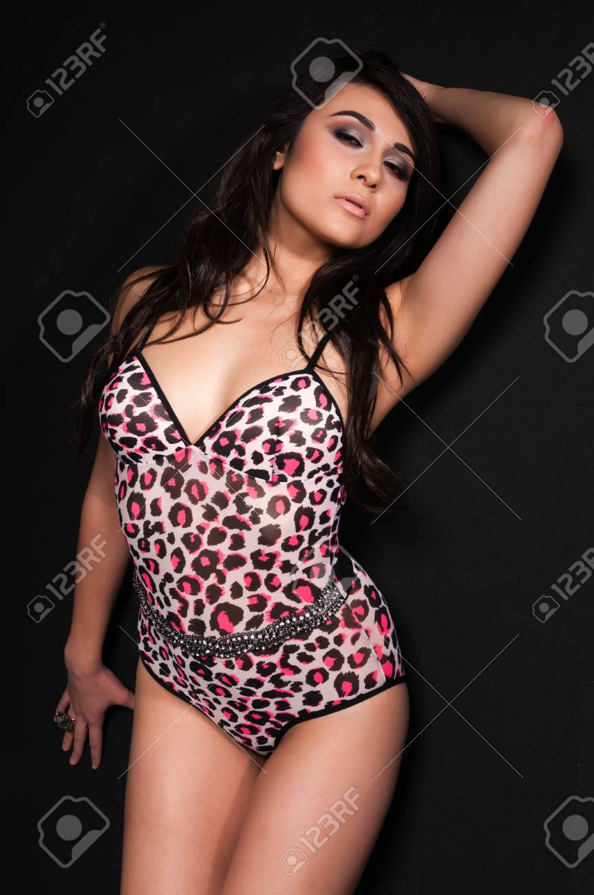 105a3455ccdc Pretty young multiracial woman in an animal print leotard Stock Photo -  11737026
