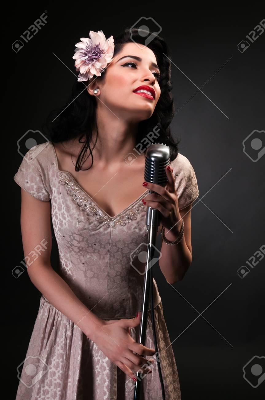 Brunette chanteuse in a cream colored dress Stock Photo - 12338266
