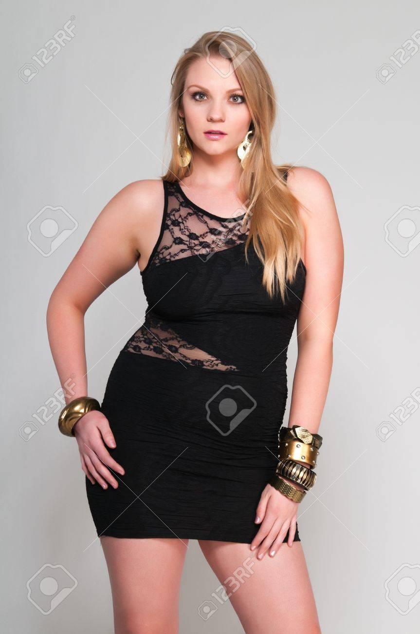 Pretty young plus size blonde in a black dress Stock Photo - 13162544