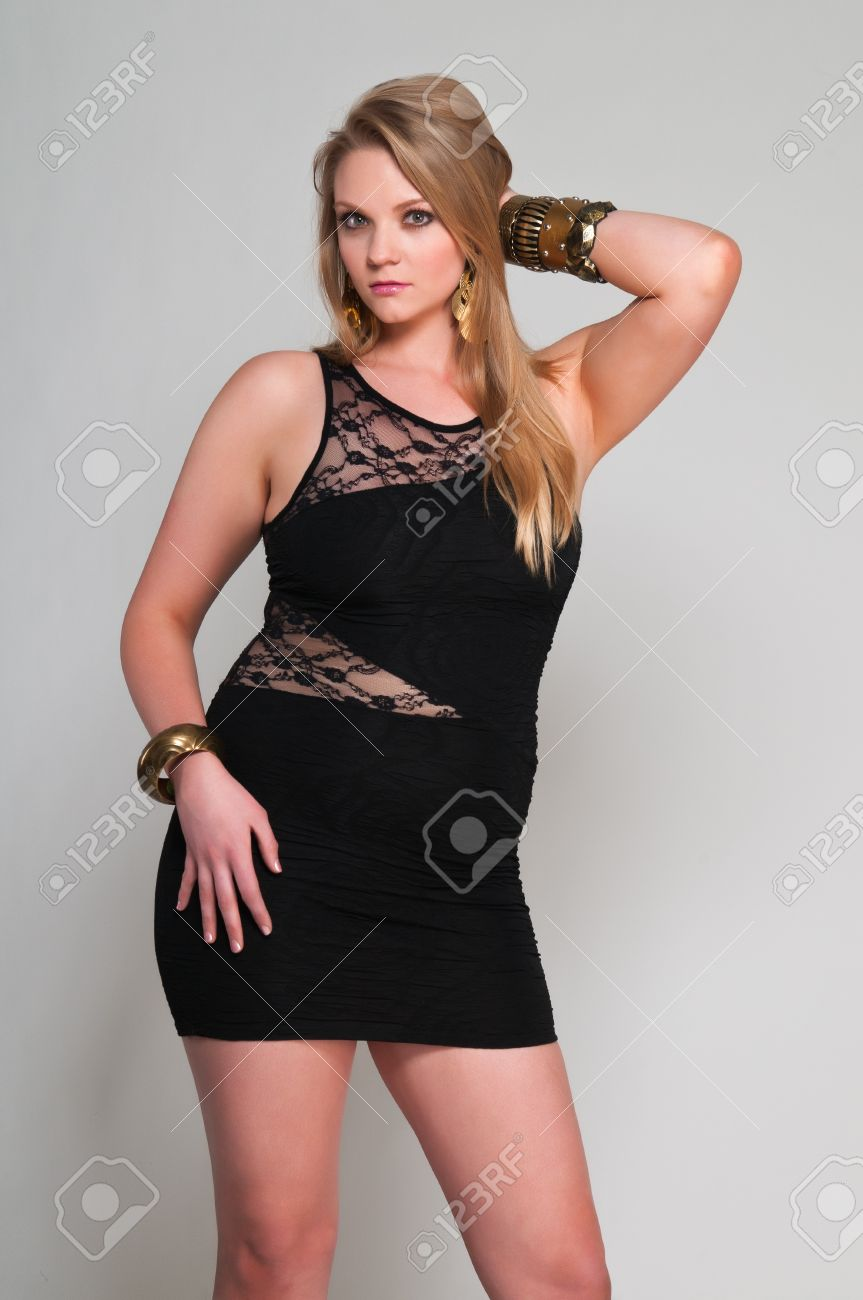Pretty young plus size blonde in a black dress Stock Photo - 13162542