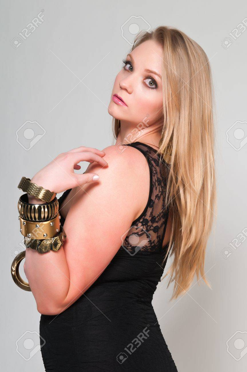 Pretty young plus size blonde in a black dress Stock Photo - 13162614