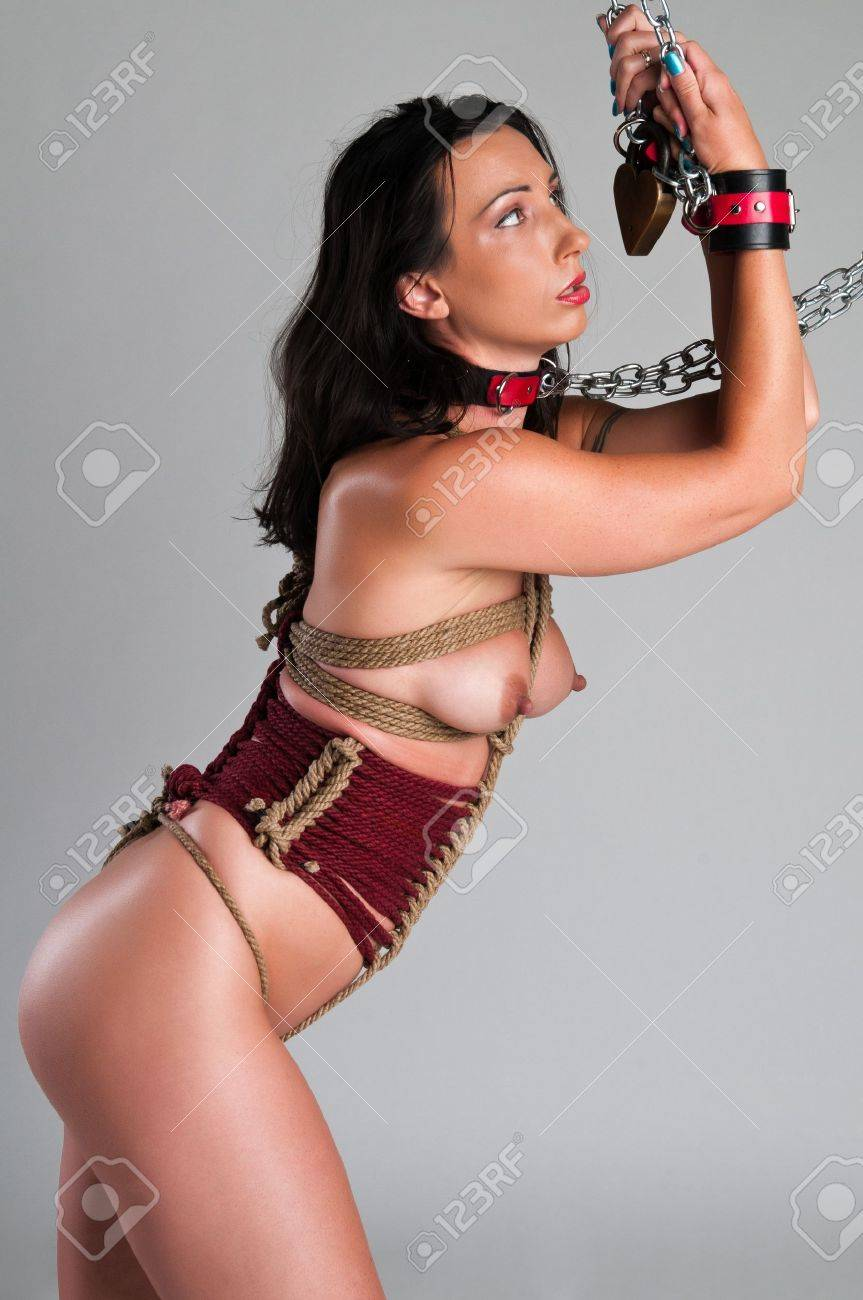 Athletic nude brunette bound with ropes and chains Stock Photo - 13335477