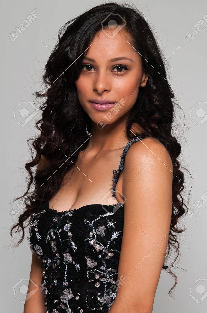 Pretty young Latina in a black sleeveless top Stock Photo - 13420353