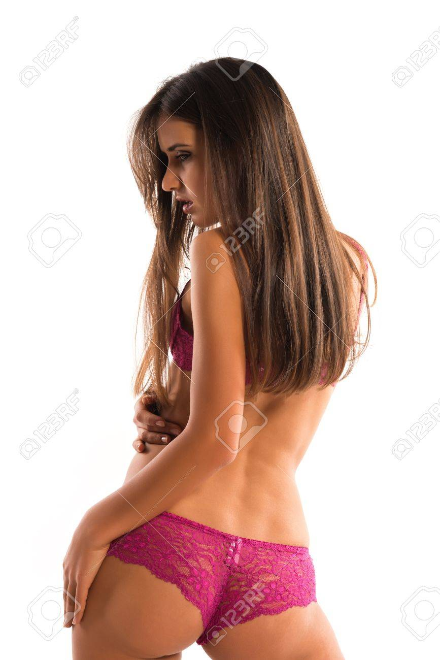 Beautiful slender Romanian brunette in rose colored lingerie Stock Photo - 15500914