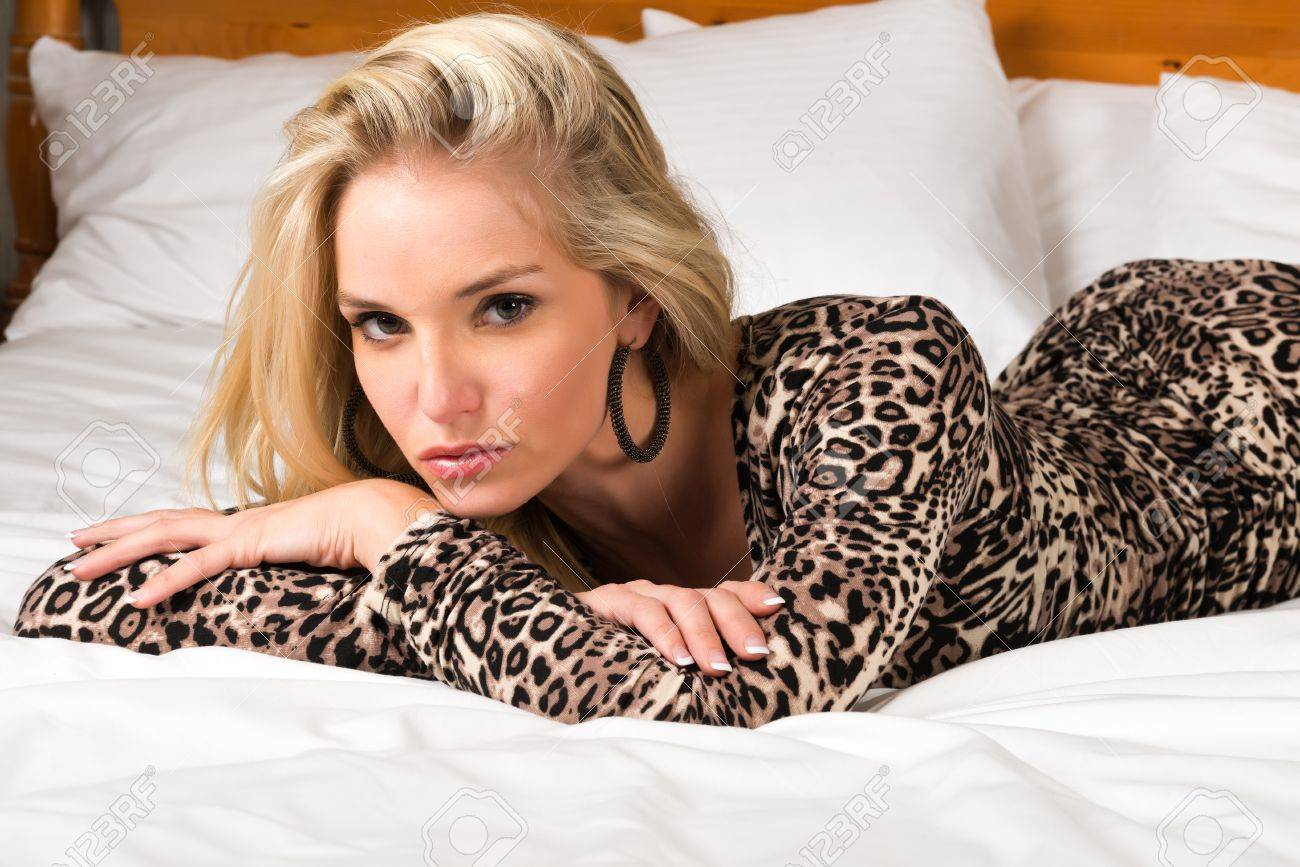 Pretty blonde woman in a leopard print dress Stock Photo - 15812289