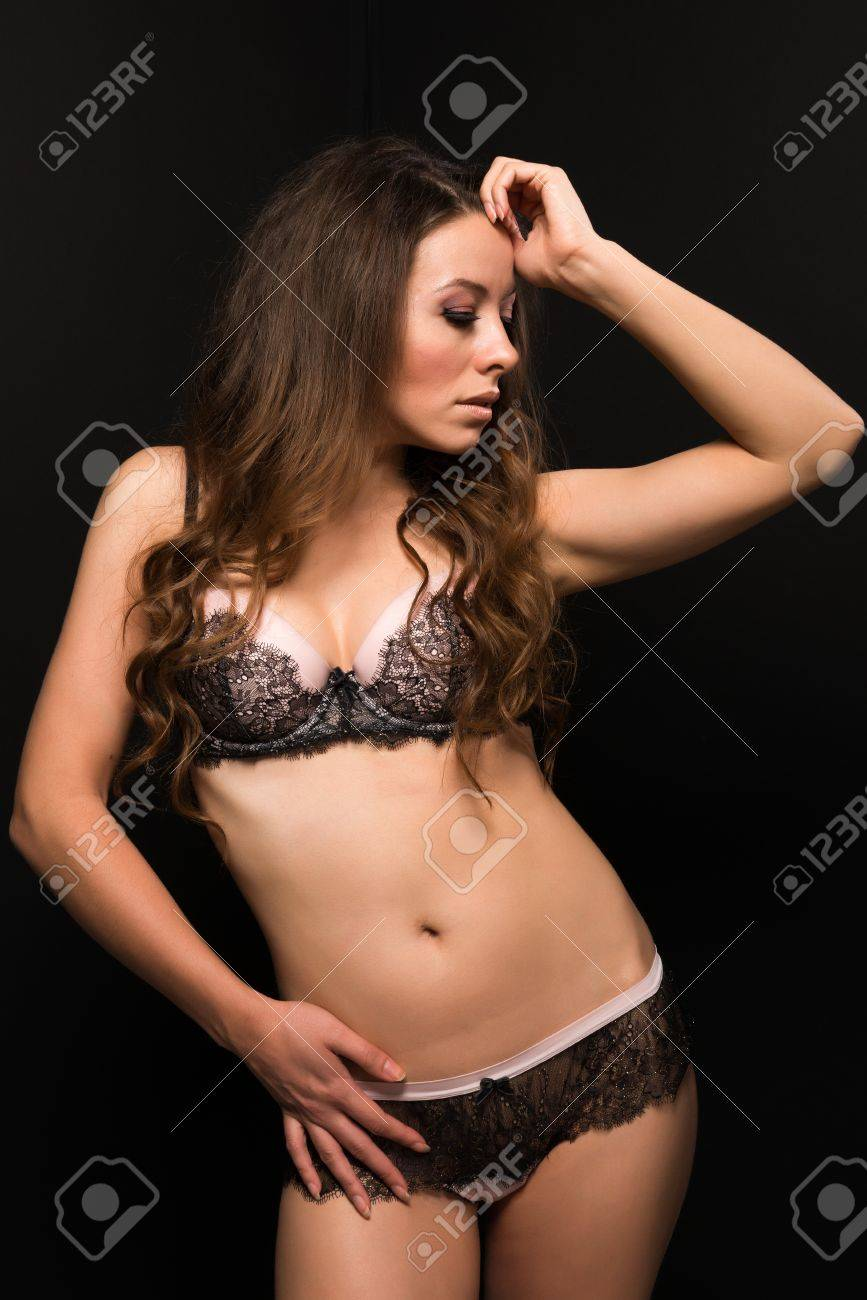 Tall Moldovan woman in pink and brown lingerie Stock Photo - 16431617