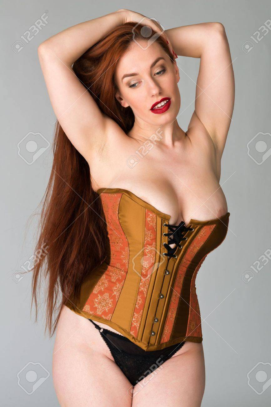 Pretty young redhead in a copper and brass corset Stock Photo - 18060919