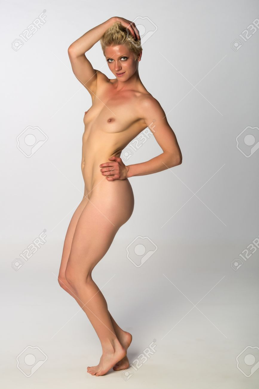 athletic woman nude Pretty athletic blonde woman nude on gray Stock Photo - 27929839