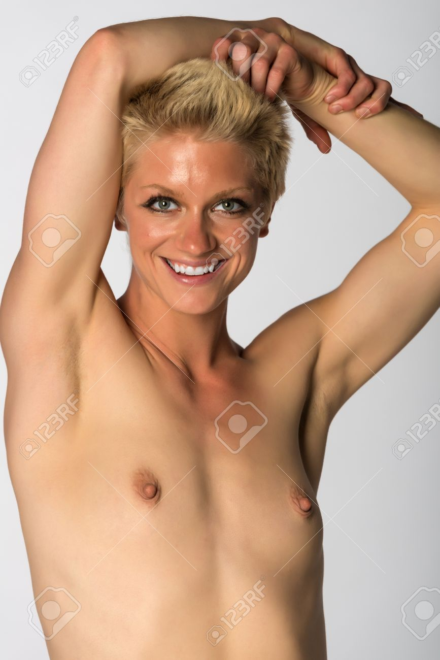 athletic woman nude Pretty athletic blonde woman nude on gray Stock Photo - 27929840
