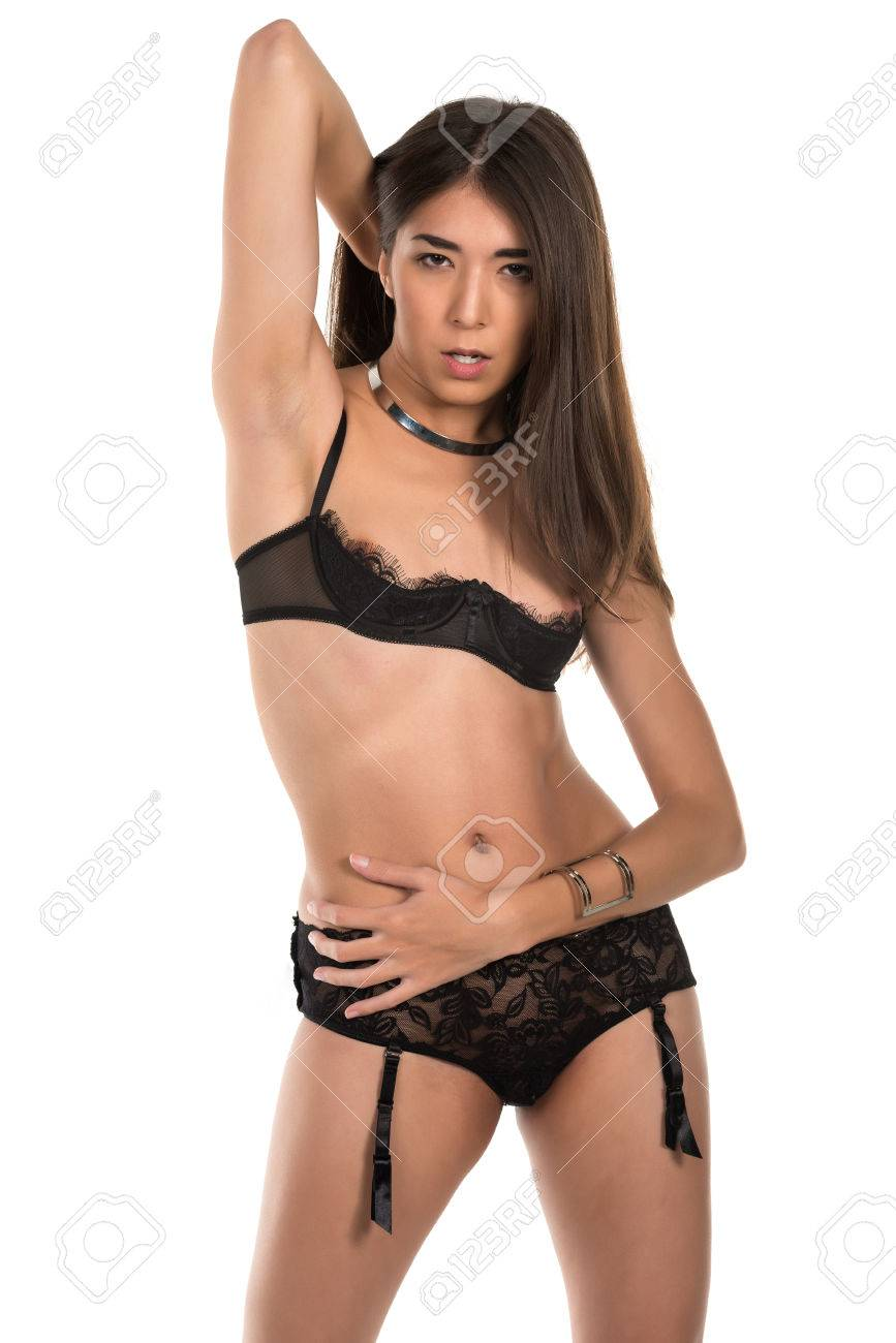e14edc38573 Beautiful petite Eurasian woman in revealing black lingerie Stock Photo -  38233616
