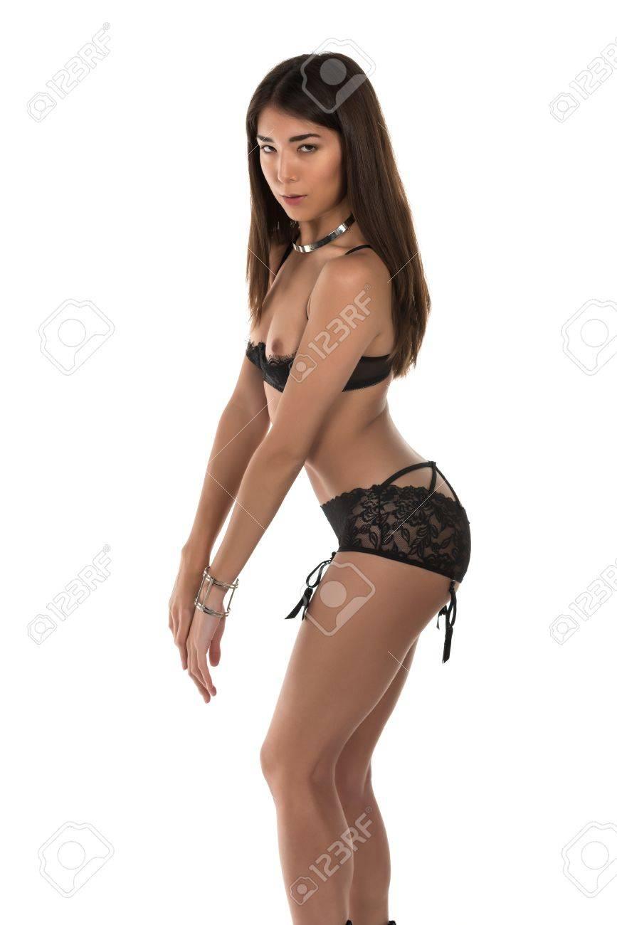 190882973f4 Beautiful petite Eurasian woman in revealing black lingerie Stock Photo -  38261408