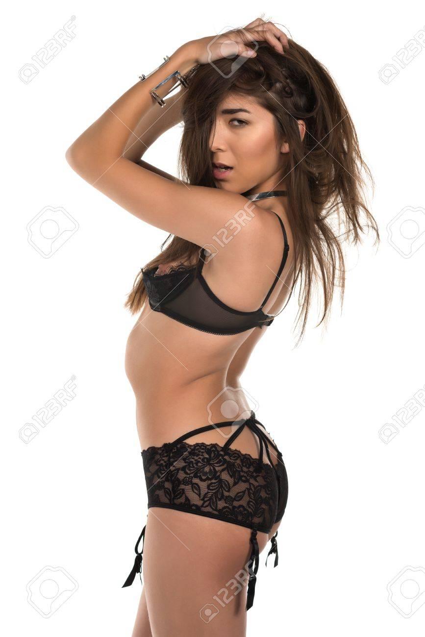 e10cf7c9410 Beautiful petite Eurasian woman in revealing black lingerie Stock Photo -  38261416
