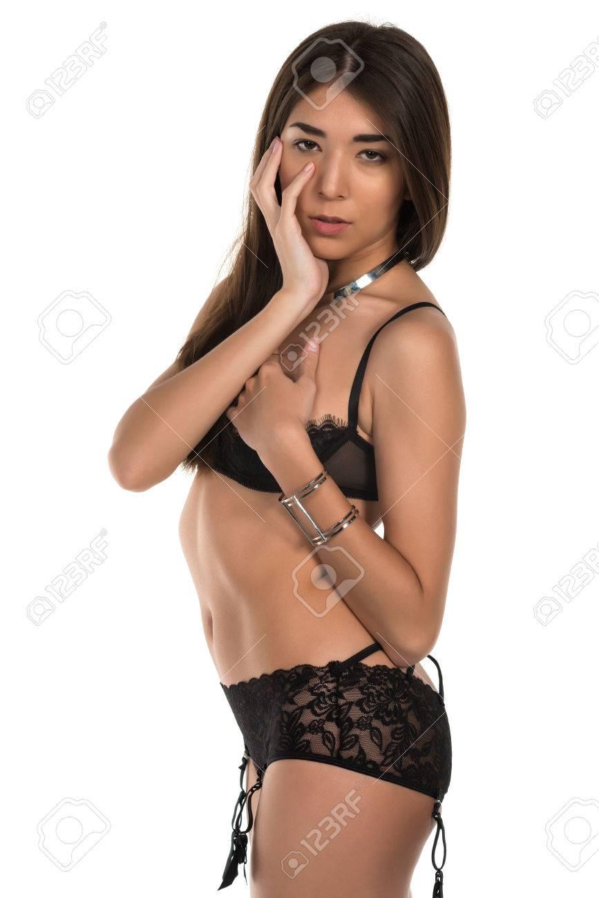 159d0ea244a Beautiful petite Eurasian woman in revealing black lingerie Stock Photo -  38543914