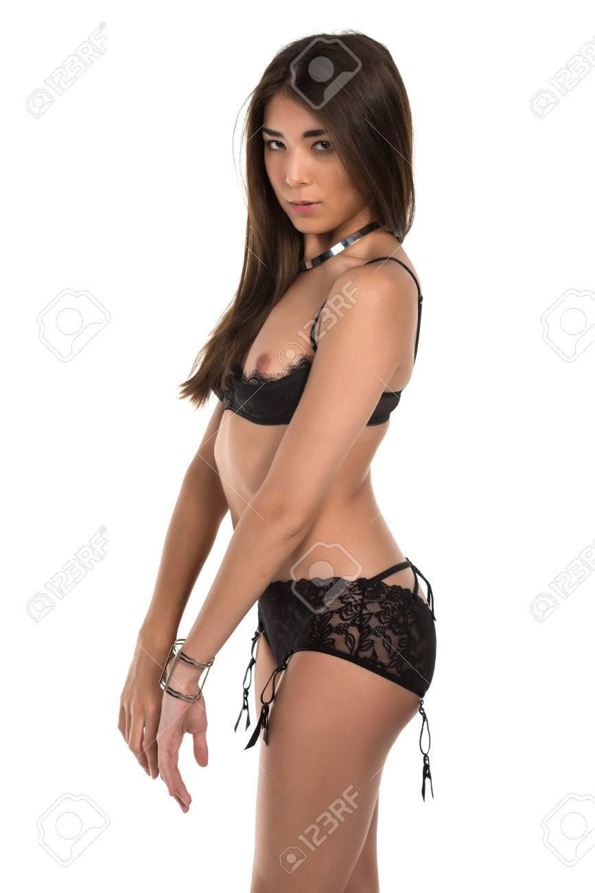 856bf654663 Beautiful petite Eurasian woman in revealing black lingerie Stock Photo -  38543976