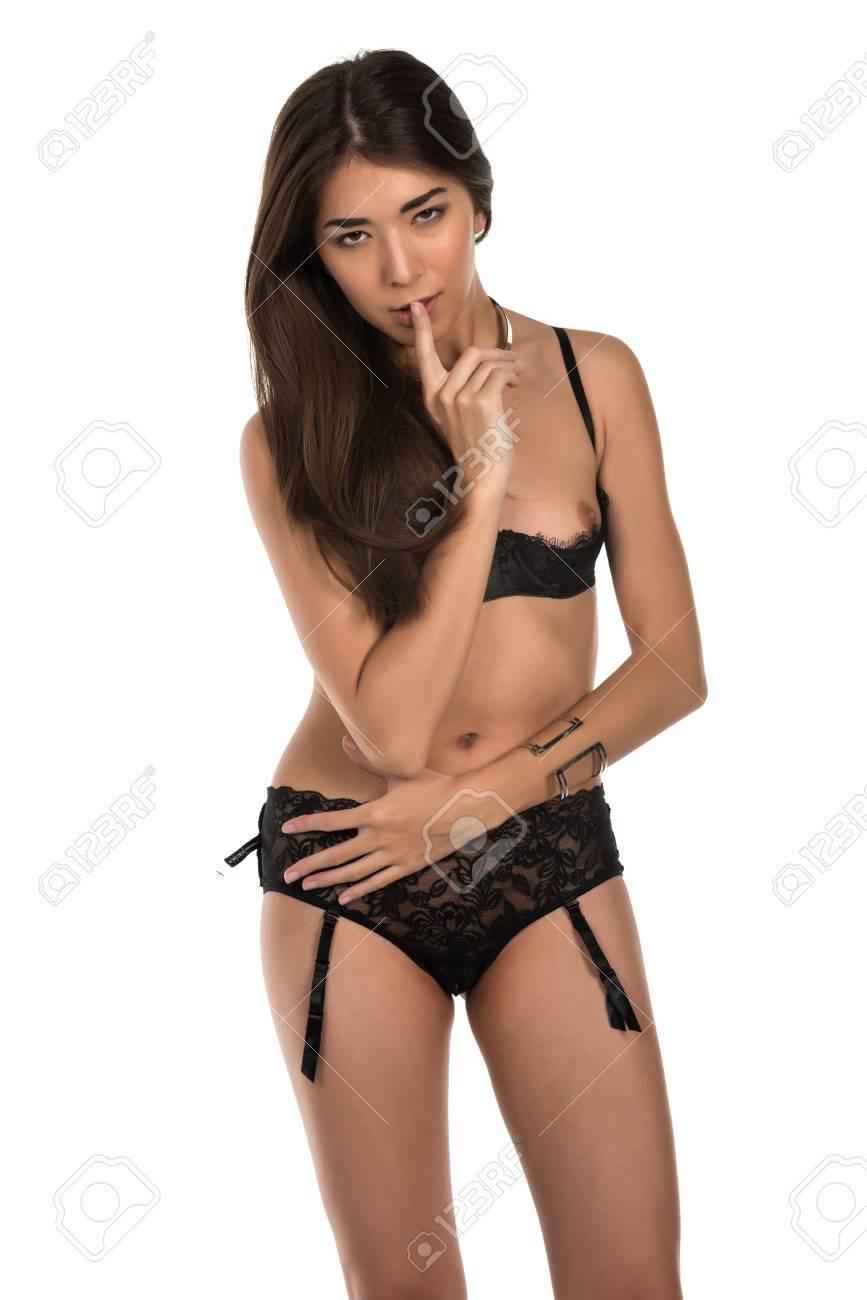 c661432c588 Beautiful petite Eurasian woman in revealing black lingerie Stock Photo -  38544051