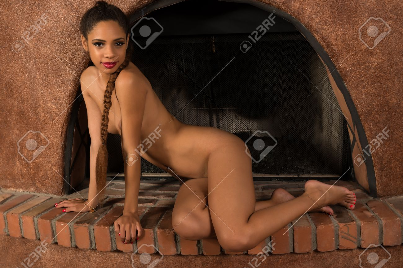 Beautiful Young Multiracial Woman Nude In A Fireplace Stock Photo ...