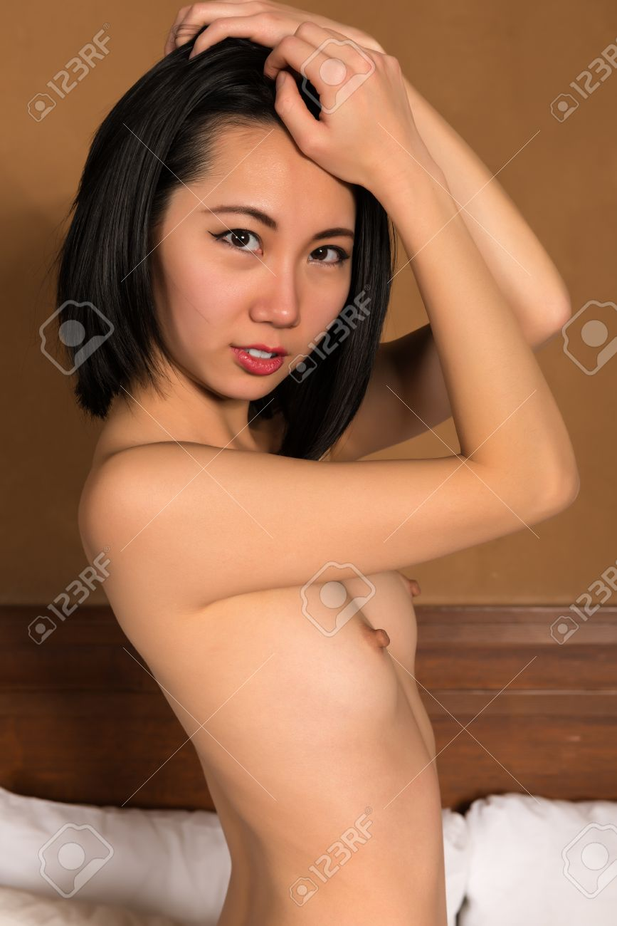 Pretty Slender Chinese Woman Nude In Bed Stock Photo Picture And