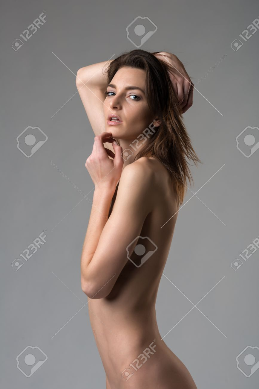 beautiful slender italian woman nude on gray stock photo, picture
