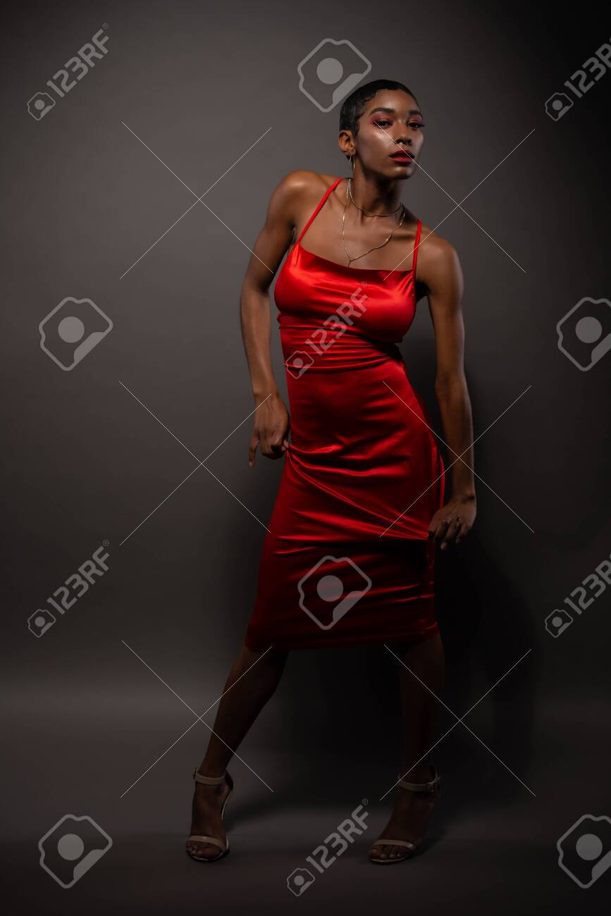 Slender young African American woman in a tight red dress - 143400897
