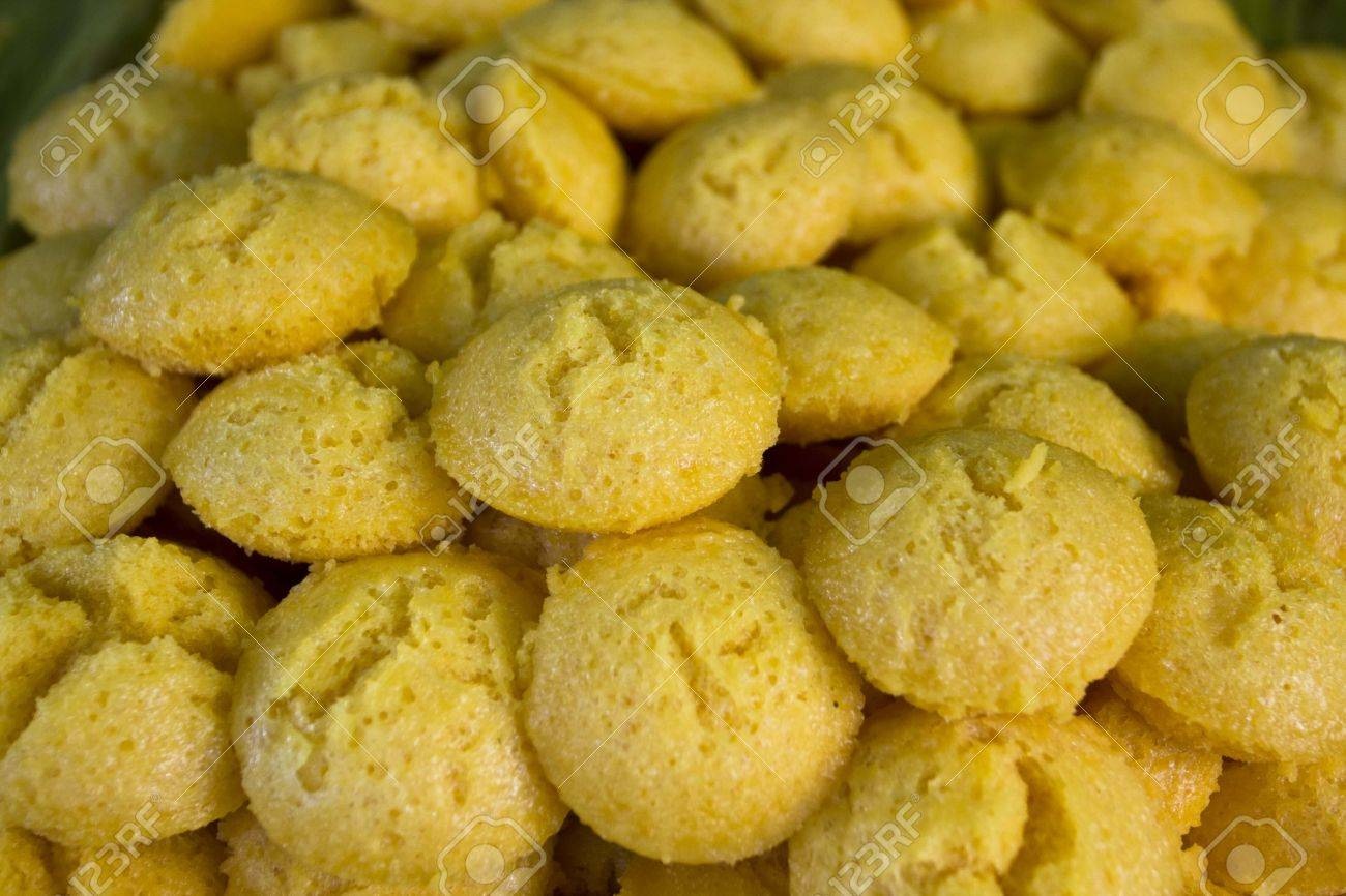 Sugar palm cupcake is a Thai traditional snack  Thai call  Khanon Tan  made from a powder of plam s seed mix with coconut milk and sugar, steam   The yellow color from original plam seed and smell is very tempting  Eat as snack with coffee or tea Stock Photo - 12931675