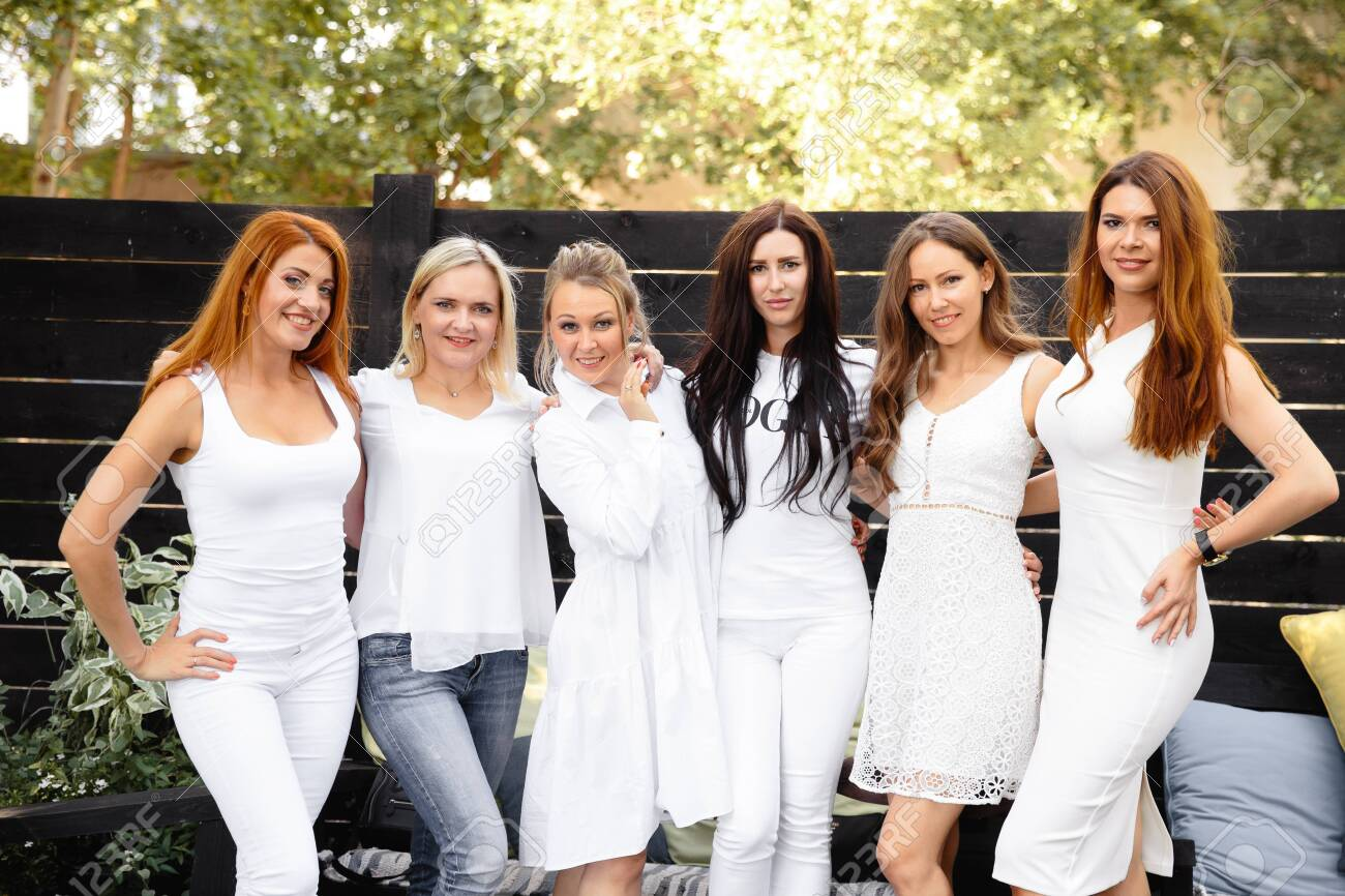 Group Of Friends In White Preparing To Pose For A Photoshoot Stock Photo Picture And Royalty Free Image Image 130322477