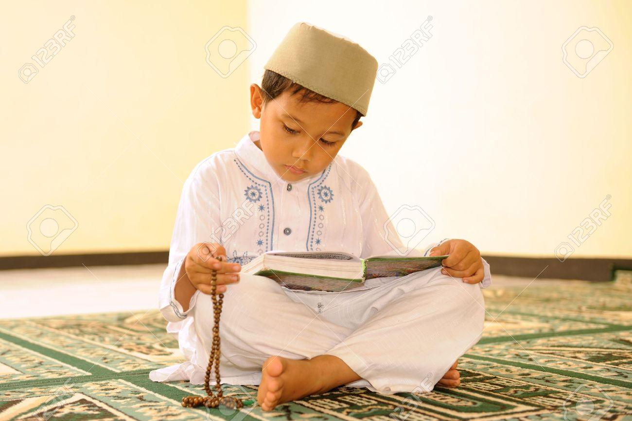 Muslim Child Reading Qur'an