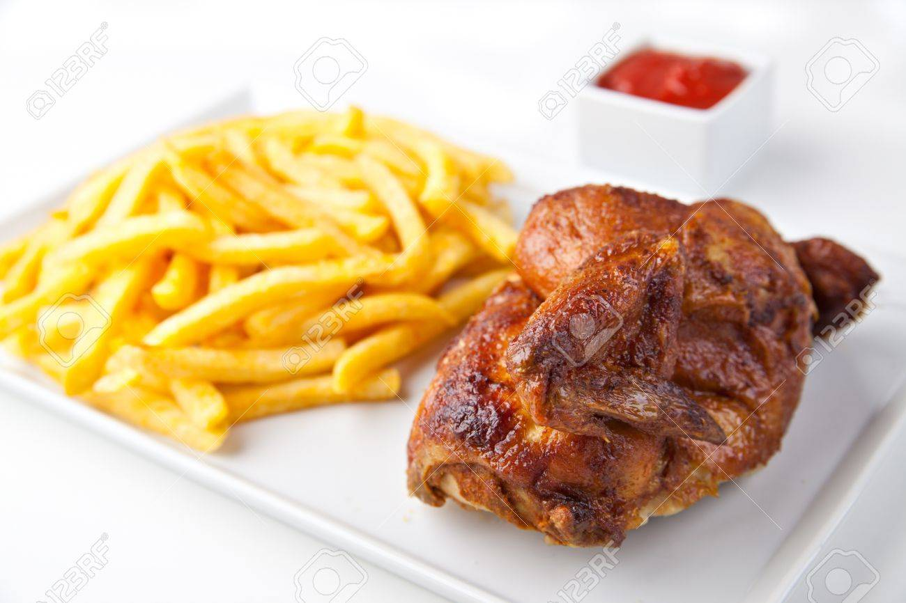 Grilled roasted half chicken with chips and ketchup - German Fast Food Stock Photo - 16316471