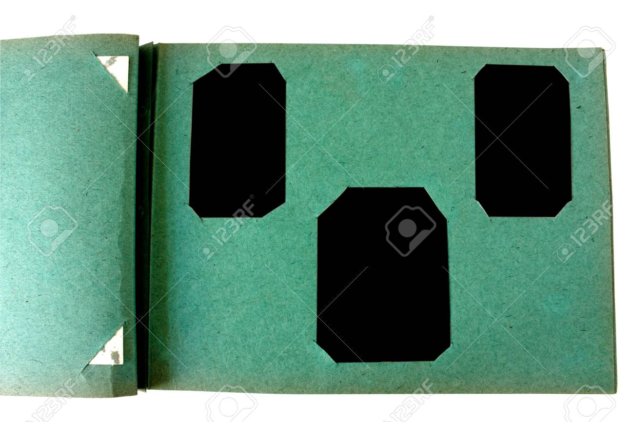 Vintage photo album with blanked photoframe isolated on white Stock Photo - 8341721