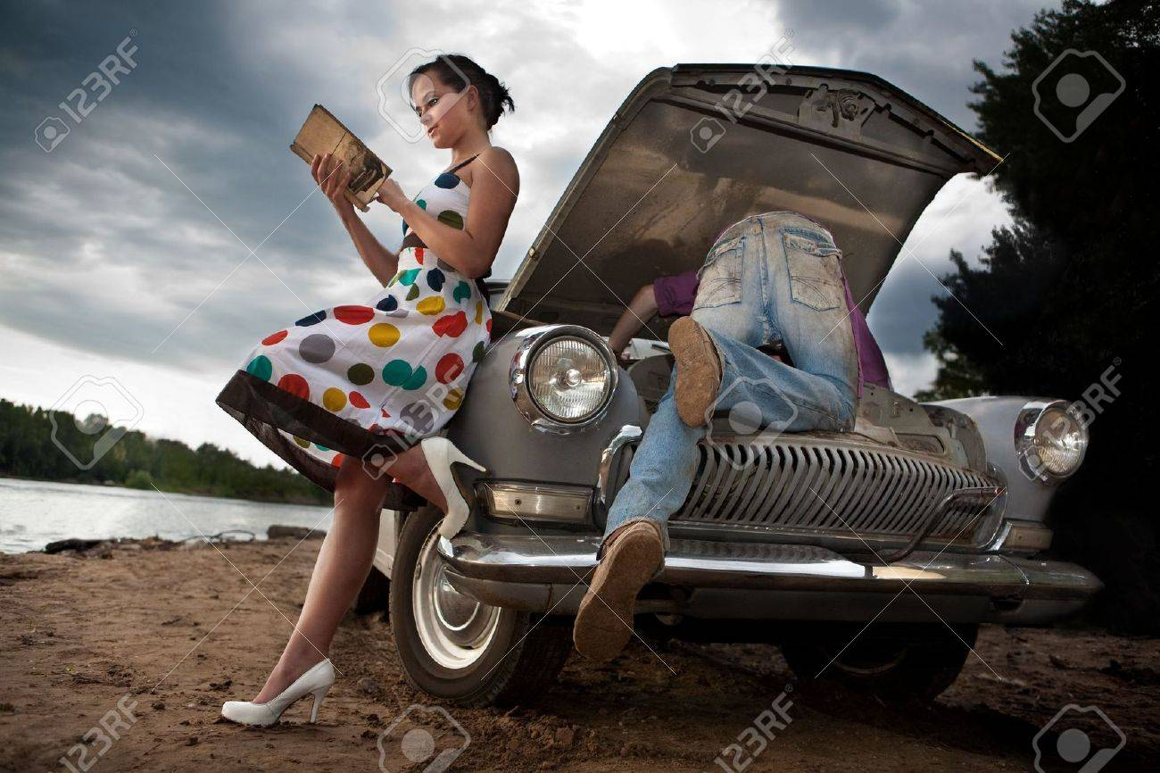 Pretty Couple Is Trying To Repair Their Old Car Using Manual Stock Photo Picture And Royalty Free Image Image 5057631