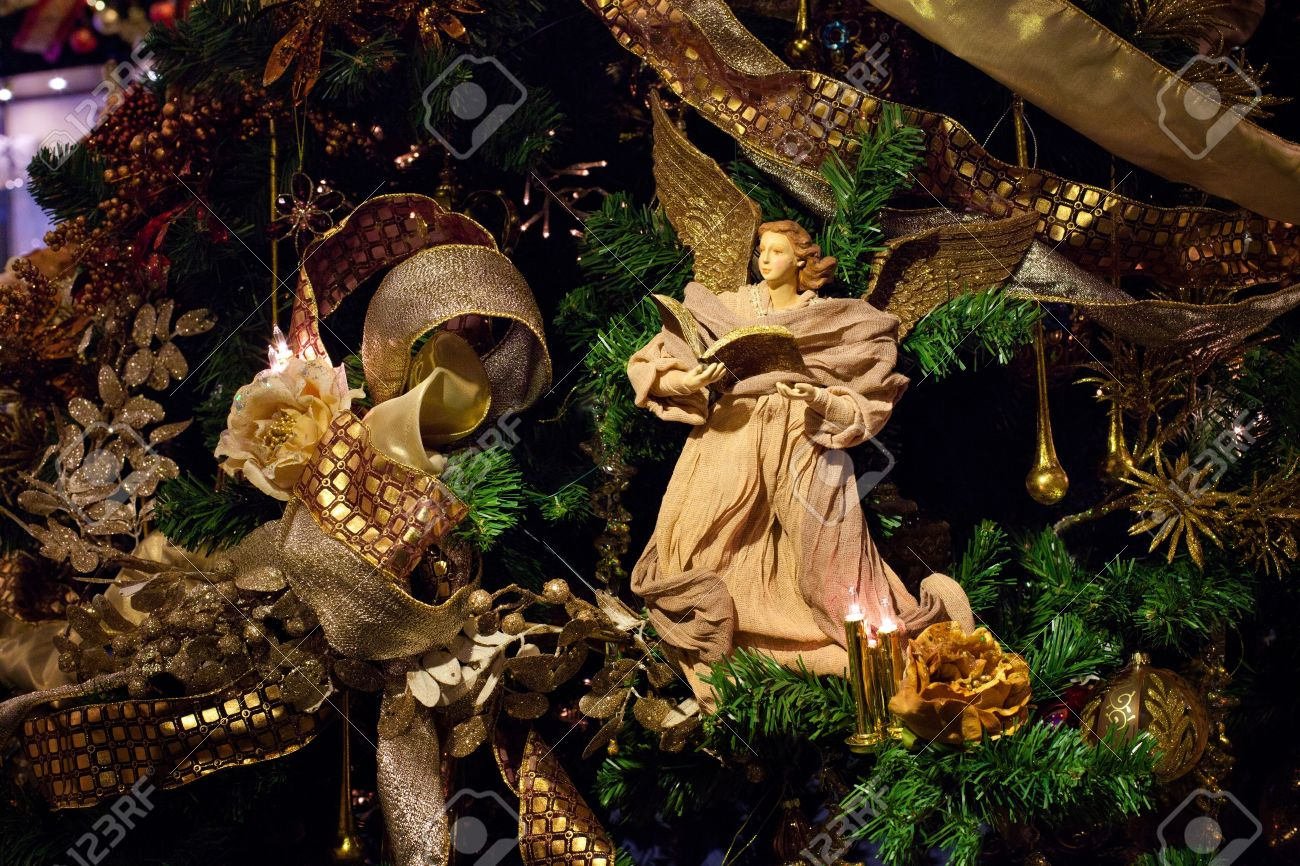 decoration on the christmas tree angel with the book stock photo 11453359 - Angel Christmas Tree