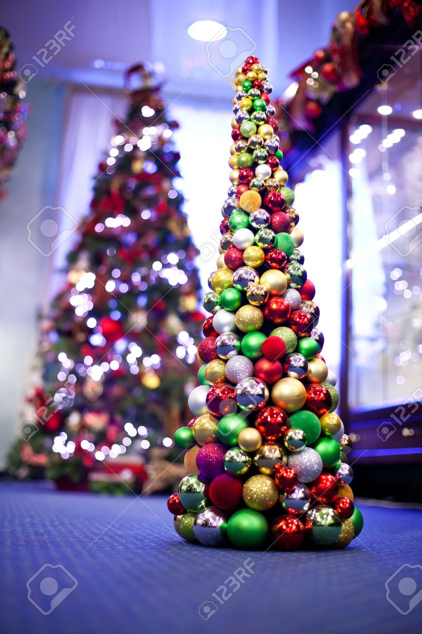 Christmas Tree Made From Colourful Balls Another On The Background Stock Photo