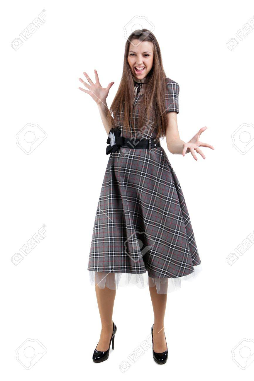 Funny gesticulating student girl in checkered skirt. Isolated on white Stock Photo - 13145827