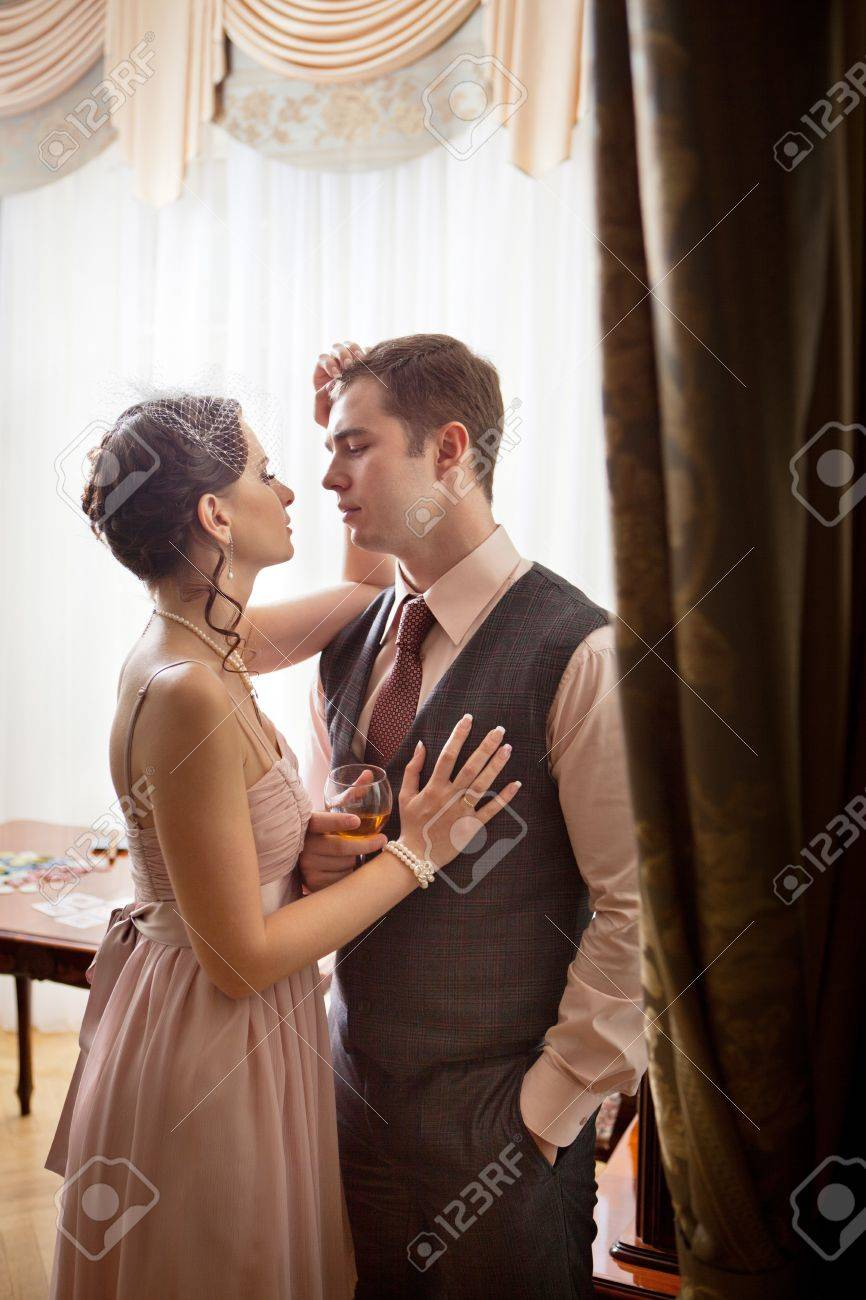 Kissing couple on the vintage interior background. Stock Photo - 13487124