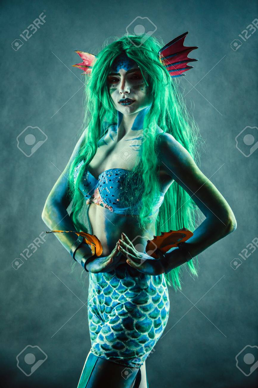 Beautiful Mermaid With Green Hair Portrait In Shadows Stock Photo