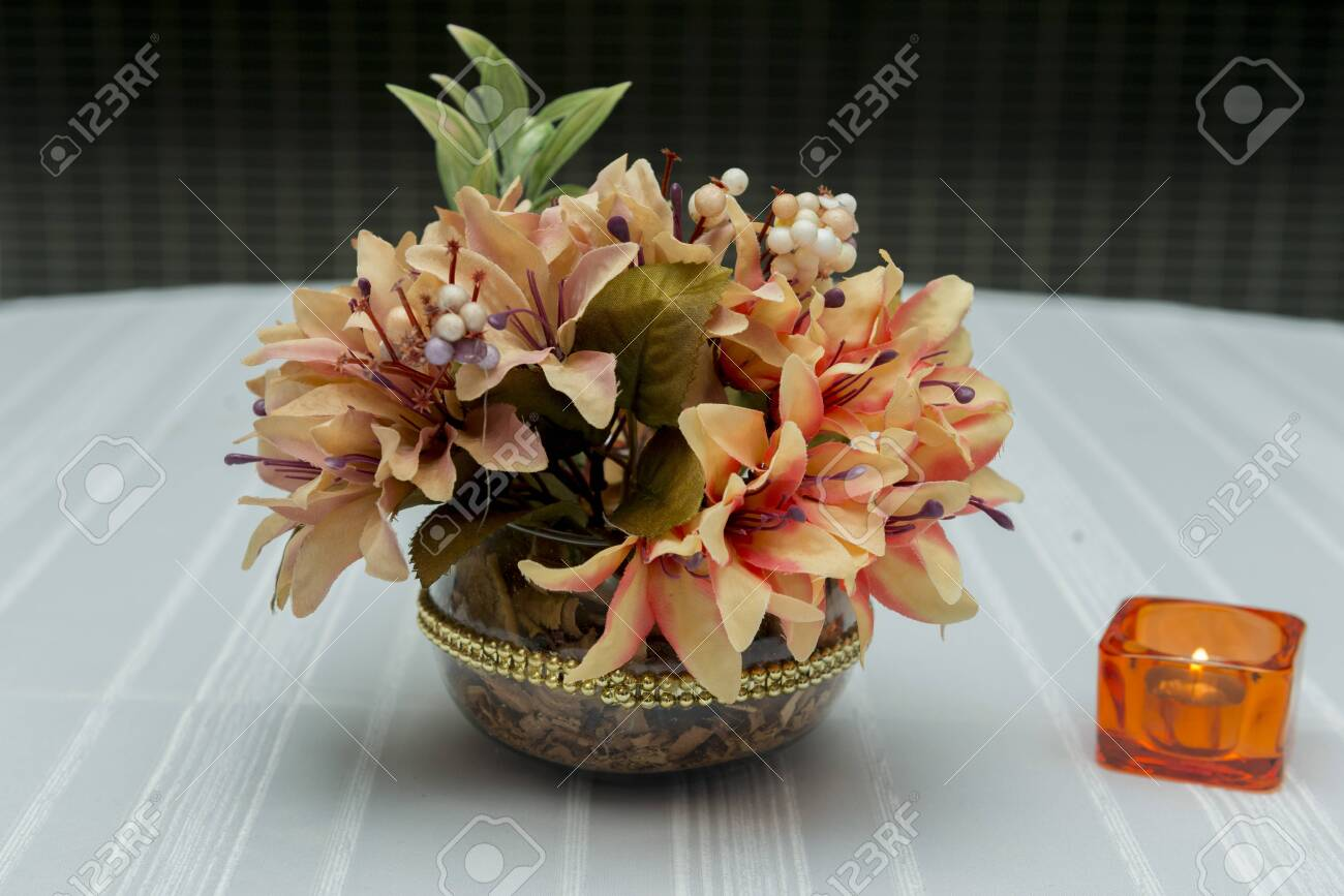 Decorative Flowers In Beautiful Vase On A Dining Table Next To Stock Photo Picture And Royalty Free Image Image 137577921