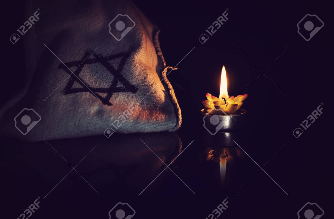 burning candle and the Star of David against a black background. - 81299308