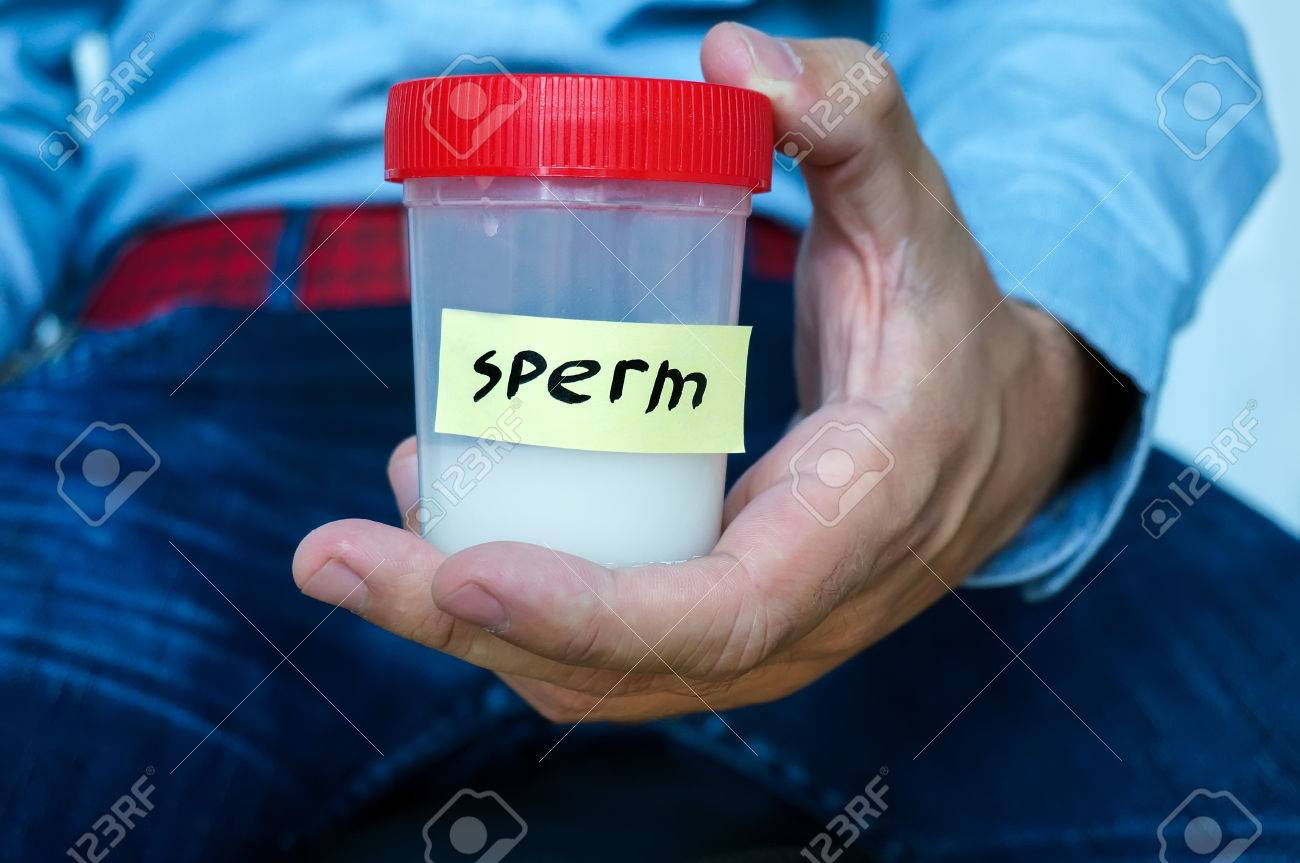 Close of man hands holding sterile sample container bottle for medical analysis. Health care and medical concept - 81633817