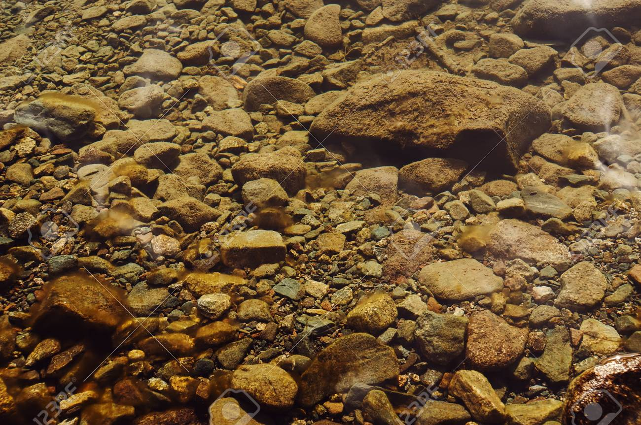 Stones under water at the bottom of the river - 84000263
