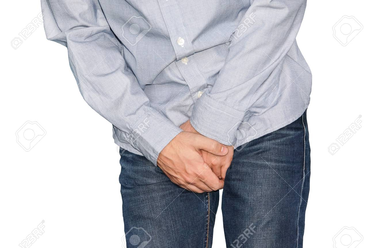Close up of a man with hands holding his crotch, isolated in white. Urinary incontinence. Disease for men. Men's health. - 88179655