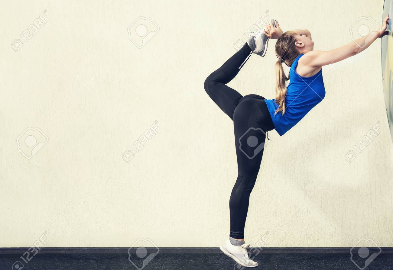 Pretty Blonde Woman With Slim Body Stand In Yoga Pose With One Stock Photo Picture And Royalty Free Image Image 103859570